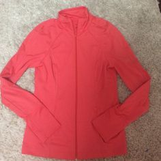 NWOT coral Zella workout jacket full zip small Adorable NWOT Zella full zip coral workout sweater size small. Perfect condition . Thumb holes . 87% polyester 13% spandex. Form fitting lululemon athletica Tops Sweatshirts & Hoodies