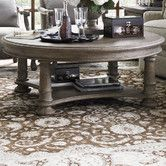 Would have to measure but a pretty table. Found it at Wayfair - La Tourelle Marceau Coffee Table