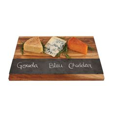 Set a handsome display of cheeses, fruits, and more on this stunning wood cheese block. The top side features a wide stripe of slate chalkboard to label your tasty morsels, and includes food-grade soap...  Find the Slate Stripe Cheese Board, as seen in the The Vintage Creamery  Collection at http://dotandbo.com/collections/the-vintage-creamery?utm_source=pinterest&utm_medium=organic&db_sku=TFS0111