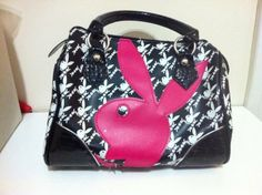 Playboy black and white purse with a large pink playboy bunny logo