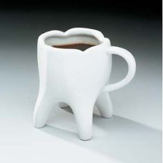 Molar Mug - we love it! Just remember that drinking coffee and tea can stain your teeth. Brush and flossing daily as well as visiting your dentist regularly can help keep your teeth healthy, bright, and white.