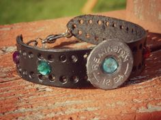 Upcycled Shot Gun Shell Cuff Bracelet, Made from a spent 12 Gauge Remington Shot Gun shell! The middle shell end has a turquoise color gem in
