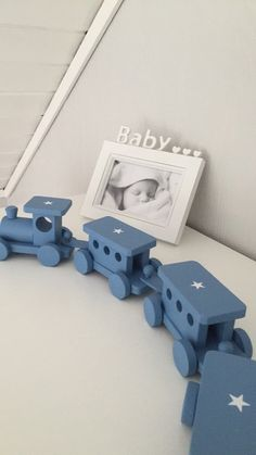 Wooden toy train spraypainted greyish blue with star stickers