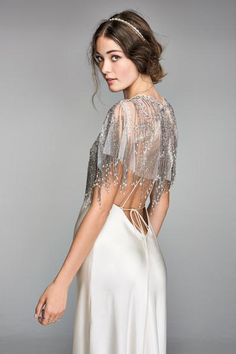 7c9cda649 Layers of polished beading delicately drape the shoulders to leave a  lasting impression over any simple