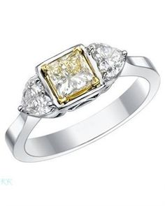 Yellow diamond surrounded by two heart diamonds!  1.24 CTW Diamonds Ring 14K Two Tone Gold
