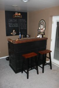 Stand alone bar made from two old doors cut down and a remnant from a structural beam