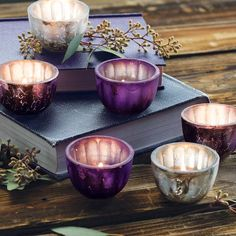 Pretty and petite, jewel toned amethyst and silvered mercury glass tealight cups paint the room with colorful candlelight. Cups measure 2 1/2 in diameter by 1 1/2 tall and set of six comes gift wrapped along with twelve tealight candles in a hand crafted wood crate with ribbon.