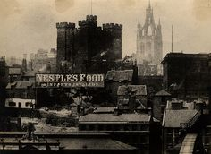 A view of Newcastle upon Tyne taken c.1890. The roof of the Fish Market is in the foreground to the left with other buildings on the Quayside to the right. In the centre there are the rears of buildings on the streets which lead up to the Keep and the Moot Hall.