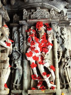 "Temple scene: A shot of red puja flowers in India, by Gordie Hull, from the book ""Tory Burch In Color"""