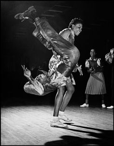 """USA. New York City. Harlem. 1939. Savoy Ballroom. One of the great dancers of Lindy Hop in the Kat's Corner at the Savoy Ballroom: Gladys CROWDER and Eddie """"Shorty"""" DAVIS. The woman in the background: Mickey JONES."""