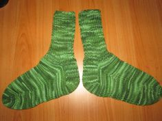 Here is a wonderful pair of hand knit adult size socks. The color is called Green Tones. Heel to toe is approx. 9 in. and the ribbing on the top (top to ankle) is approx. 7 in. These socks are made of 100% acrylic yarn and can be machine washed and dried.
