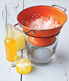 Stash ice in a colander set on top of a bucket or bowl.  Water will drain out, and guests will get only the solid stuff.