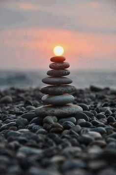 What a great picture. I love these balanced beach stones. Very zen.