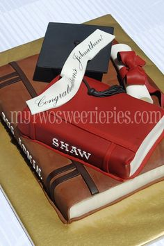 Stacked book cake with diploma and cap.
