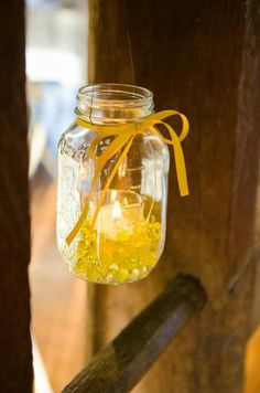 Hanging mason jar candels with yellow water beads