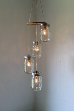 summer breezes spiral cascading mason jar chandelier swag style hanging pendant lighting fixture - Rustic Wedding BootsNGus Lamp Design. $100.00, via Etsy.