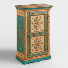 Our handcrafted cabinet showcases delicate traditional Indian motifs and floral patterns against an ivory background.  Featuring an interior shelf, this piece offers convenient storage and global style.