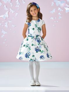 Joan Calabrese for Mon Cheri - 117353 - Printed Mikado knee-length A-line dress features cap sleeves, jewel neckline, deep scoop illusion back with three-dimensional beaded flowers down center, set-in waistband, box pleated skirt.Sister dress to style 117354.Sizes: 2 – 14Color: Ivory/Multi