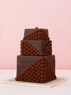 Sweet idea to add truffles to the wedding cake- for people who don't like cake, or people who really like chocolate!