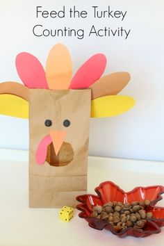 Use acorns to feed the paper bag turkey - practice counting and fine motor skills!