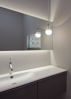Chic Led Light Strips technique Chicago Modern Powder Room Innovative Designs with backlighting bulb pendant floating mirror floating vanity gray walls integrated sink minimalist pendant