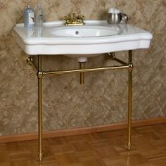 This stunning console sink marries the best of contemporary and traditional styles. With its brass stand and oversized basin, the Pennington Console Sink is perfect for adding a unique piece to your lavatory area. Vintage Bathroom Sinks, Brass Bathroom, Bathroom Sink Faucets, Bathroom Fixtures, Bathroom Plumbing, Plumbing Pipe, Upstairs Bathrooms, Downstairs Bathroom, Cottage Bathrooms