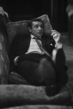 Bond enjoys a smoke after a hard day of counter espionage (or more likely after shagging a Bond girl).