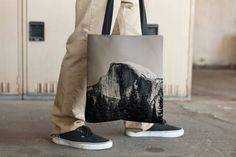 """Excellent quality tote bag. Thick and sturdy enough to hold heavy books.     This shot is of the Half Dome, in the Yosemite NP, California. One of the most, if not the most, iconic place in the USA.    100% spun polyester weather resistant fabric  Dual handles 100% natural cotton bull denim  Bag 15"""" x 15"""" (38.1cm x 38.1cm)    Made in California    Close-up shot is from a different tote.    Please remember that depending on your screen, color accuracy and vibrancy may vary from the product…"""