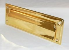 """Solid Brass Mail Slot 2 1/2"""" X 8"""" by Ultra Hardware. $50.00. Ultra Hardware 67029 Deluxe Solid Brass Letter Slot  Finish: Brass  Material: Deluxe Solid Brass  Type: Fully hinged spring loaded single  Size: 2-7/8"""" x 8-3/4"""" outside flap with inside frame  Openings conform to postal regulations  Furnished with screws  NOTE: For use with wood and metal doors  Pack: Card  UPC: 749694670297"""