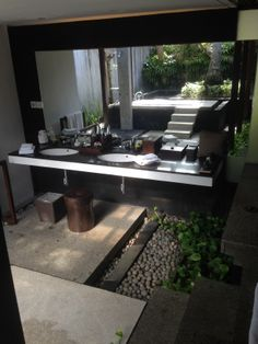 The outdoor bathroom at our Villa; Kayumanis Estate, Jimbaran, Bali - used the mirror reflection to get it all in. Bliss!