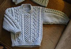 Ravelry: Child's Aran Sweater pattern by Melinda Goodfellow Free Aran Knitting Patterns, Baby Boy Knitting Patterns, Baby Cardigan Knitting Pattern, Knitting For Kids, Aran Sweaters, Knit Baby Sweaters, Boys Sweaters, Creative Knitting, Knits
