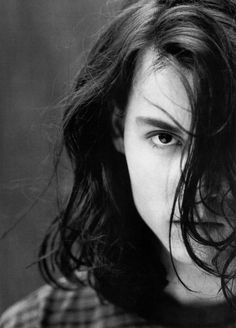 Young Johnny Depp with seductive, long hair.