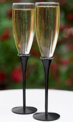 Deco Glam Black Stem Champagne Glasses (Hortense B Hewitt 33307) | Buy at Wedding Favors Unlimited (http://www.weddingfavorsunlimited.com/deco_glam_toasting_flutes.html).