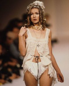 Kate Moss, walking for John Galliano at one of her first runways, at the age of 17.