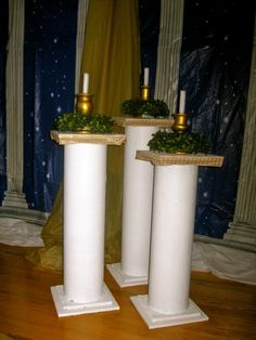 Build sturdy pillars from tubes bought at the hardware store and attached to wood, painted, etc.