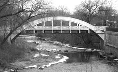 """This architecturally significant """"Rainbow Arch Bridge"""" is a classic example of the small reinforced concrete bridges which began appearing around the US in the 1890's and were built in large numbers in the early 20th century. This bridge was built in 1916 at the cost of 13,950 dollars. It was the only Duncan Creek bridge that survived the destructive flood of 1934."""