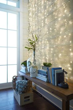 Hang a set of Pier White Multi-Strand Glimmer Strings:registered: to create a subtly glowing backdrop. They use tiny LEDs on a curtain of shapable, thread-sized silver filament strings to create a firefly-like effect indoors and in covered outdoor areas.