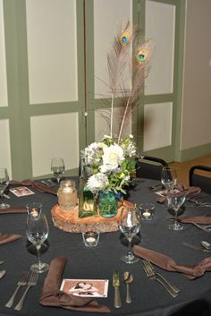 Peacock Inspired Vintage Wedding Centerpiece and table setting
