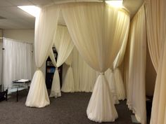 A very full and elegant pavilion set up in the office for customers to see. It is the newest idea in event draping.