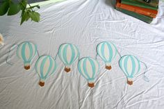 Hand Painted Hot Air Balloon Garland, Sky Blue. $30.00, via Etsy.