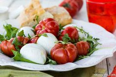 This simply exquisite Tomato, Mozzarella and Arugula Salad With Anchovy Dressing salad is perfect for spring and summer, enjoy it bite by delicious bite. #capresesalad, #mozzarellaandtomatoes, #arugula, #healthyrecipe, #italiansalad