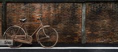 Old bike, old wall 02 by David Davenport on 500px