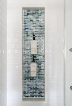 Modern Classic Guest Bathroom Makeover Reveal 2019 large shower niche with glass tiles and glass shelves. Blue glass shower inset with white subway tile surround The post Modern Classic Guest Bathroom Makeover Reveal 2019 appeared first on Shower Diy. Glass Tile Shower, Tile Shower Niche, Glass Tiles, Shower Accent Tile, Blue Glass Tile, Glass Subway Tile, Glass Shelves In Bathroom, White Subway Tile Bathroom, Subway Tile Showers