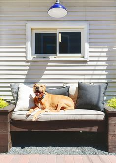 Longer days and warmer nights are the only invitation we need to move the party outdoors. Kim and Scott Vargo of Yellow Brick Home tackle their back patio just in time for summer. Crochet Pouf, Crochet Pillow, Free Crochet, Black Umbrella, Grey Pillows, Backyard Makeover, Outdoor Parties, Back Patio, Porch Swing