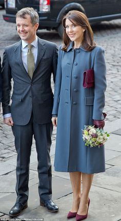 Crown Princess Mary (right) visited Tante Olga Kindergarten in Copenhagen on Wednesday with Prince Frederik (left) and the Icelandic president and First Lady on their tour of Denmark