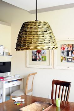 pendant light out of basket-would look cool as a bedside light or as a lamp over a side table in the living room