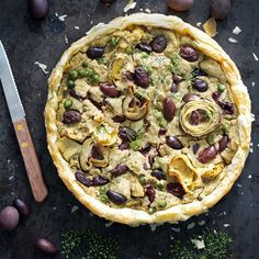 Vegan olive and artichoke tart with green peas is very simple to make, but tastes absolutely amazing. It's savory, hearty and loaded with veggies.