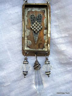 Captured Heart Necklace of Etched Bronze, Pewter Heart Embelished with Rhinestones,Sterling Wrapped Glass & Crystals Dangle from the Bezel