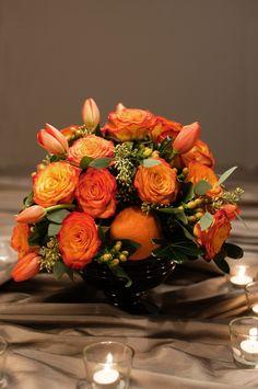 circus rose centrepiece with seeded eucalyptus tulips, hypericum and oranges | Dandie Andie Floral Designs - Mississauga, Ontario