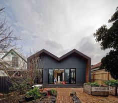 M House by MAKE Architecture @make_arch . The extension sits on the propertys north side. Its zig-zag shape is a continuation (and reinterpretation) of the more traditional double hip roof of the existing house... see this home on Dwell.com Photo: Peter Bennetts / #dwell #architecture #mebourne
